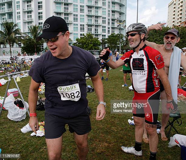 Actor Matt Damon left start his leg of the threeman team as he is cheered on by Barry Hetherington and stepfather Jay Jones who completed the swim...