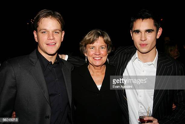 Actor Matt Damon poses with his mother Nancy CarlssonPaige and actor Max Minghella at the Syriana premiere after party at The New York Public Library...
