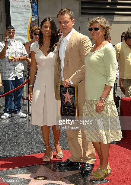 Actor Matt Damon poses with his wife Luciana Damon and mother Nancy Carlsson-Paige at the ceremony honoring him with a star on the Hollywood Walk of...