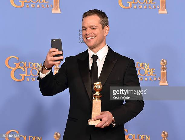 Actor Matt Damon winner of Best Performance in a Motion Picture Musical or Comedy for 'The Martian' takes a selfie in the press room during the 73rd...
