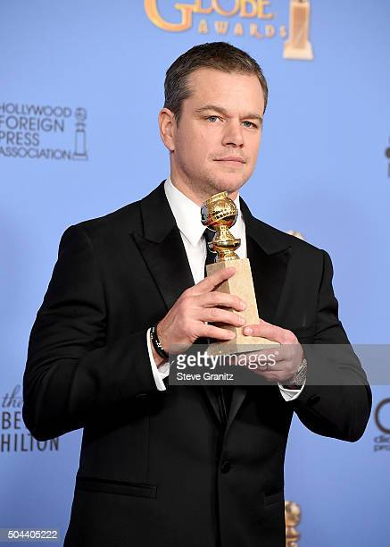 Actor Matt Damon winner of the award for Best Performance by an Actor in a Motion Picture Musical or Comedy for 'The Martian' poses in the press room...
