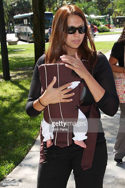 Actor Matt Damon's wife Luciana Bozan and daughter Gia Zavala Damon attend an Early Voting Rally at University of Miami on October 27 2008 in Coral...