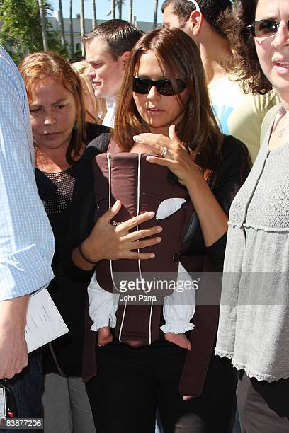 Actor Matt Damon's wife Luciana Bozan and daughter Gia Zavala Damon attend an Early Voting Rally at University of Miami on October 27, 2008 in Coral...