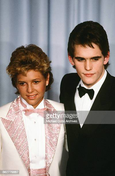 Actor Matt Dillon and actress Kristy McNichol pose backstage during the 55th Academy Awards at Dorothy Chandler Pavilion Los Angeles California