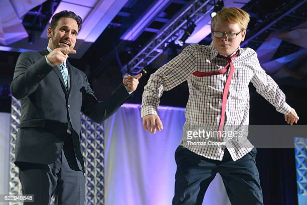 Actor Matt Dillon walks down the runway with Sam Levin at the fashion show at the Global Down Syndrome Foundation's 2016 'Be Beautiful Be Yourself'...