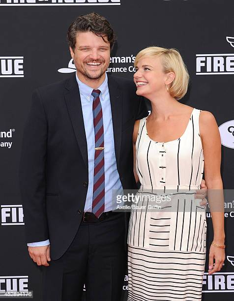 Actor Matt Jones and his wife Kelly Daly attend the premiere of 'Planes Fire Rescue' at the El Capitan Theatre on July 15 2014 in Hollywood California