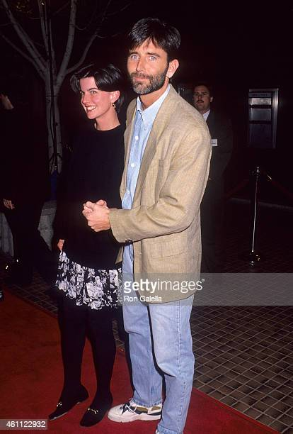 Actor Matt McCoy and wife Mary attend the Shining Through Westwood Premiere on January 24 1992 at the Avco Center Cinemas in Westwood California