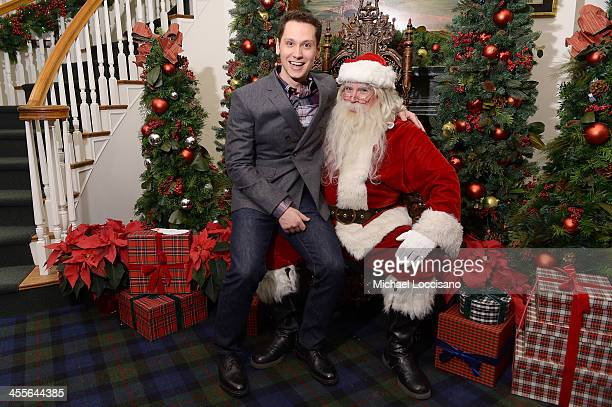 Actor Matt McGorry poses with Santa Claus as Brooks Brothers celebrates the holidays with St. Jude Children's Research Hospital on December 12, 2013...