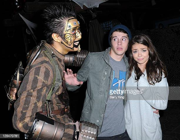 Actor Matt Prokop and actress Sarah Hyland attend Knott's Scary Farm Halloween Haunt at Knott's Berry Farm on October 13 2010 in Buena Park California