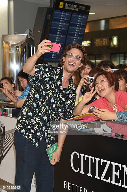 Actor Matthew Gray Gubler poses for a selfie with fans upon arrival at Narita International Airport on June 25 2016 in Narita Japan