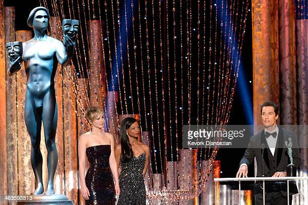 Actor Matthew McConaughey accepts the Outstanding Performance by a Male Actor in a Leading Role award for 'Dallas Buyers Club' with actress Jennifer...
