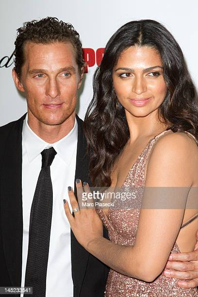 Actor Matthew Mcconaughey and Camila Alves attend the 'Paperboy' photocall at Carlton beach during the Cannes Film Festival on May 24 2012 in Cannes...