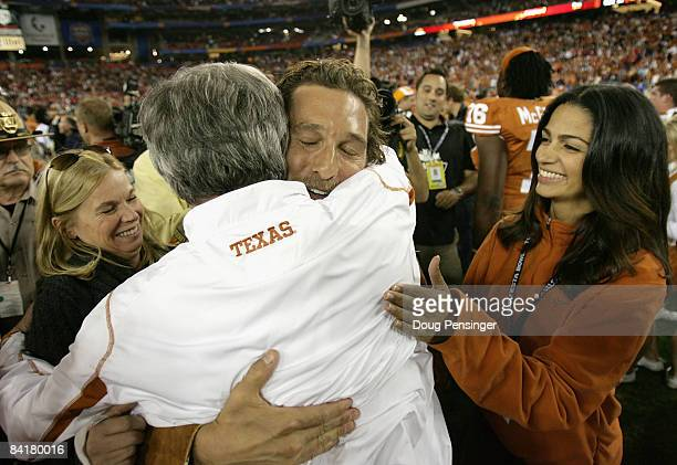 Actor Matthew McConaughey and girlfriend Camila Alves greet head coach Mack Brown after the Texas Longhorns defeated the Ohio State Buckeyes in the...