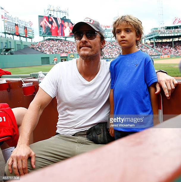 Actor Matthew McConaughey and his son Levi pose for a photo during the game between the Boston Red Sox and the Houston Astros during the game at...