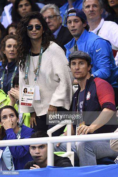 US actor Matthew McConaughey and his wife Camila Alves watch the swimming events at the Rio 2016 Olympic Games at the Olympic Aquatics Stadium in Rio...