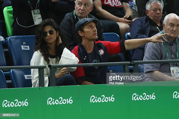 Actor Matthew McConaughey and wife Camila Alves watch the Men's Preliminary Round Group A game between Australia and the United States on Day 5 of...