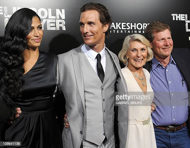 Actor Matthew McConaughey arrives with his wife Camila Alves his mother Kay McCabeat and his brother Rooster at the premiere of The Lincoln Lawyer in...