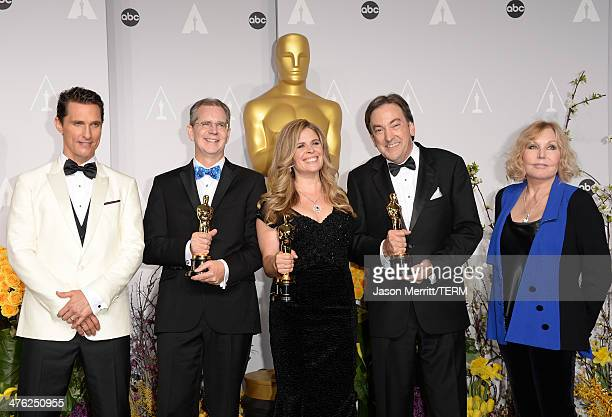 Actor Matthew McConaughey directors Jennifer Lee and Chris Buck and producer Peter Del Vecho winners of Best Animated Feature Film of the Year for...