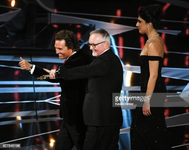 Actor Matthew McConaughey onstage with Lee Smith winner of Best Film Editing award for 'Dunkirk' during the 90th Annual Academy Awards at the Dolby...
