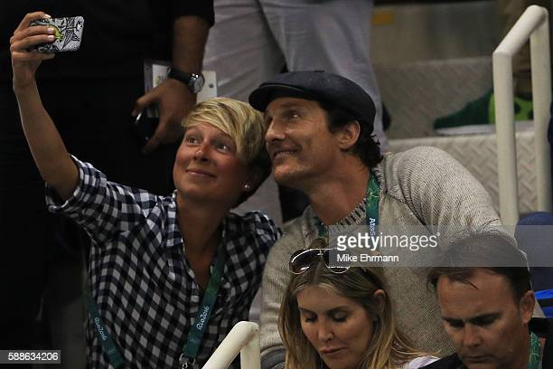 Actor Matthew McConaughey poses for a selfie with a member of the audience during the evening swim session on Day 6 of the Rio 2016 Olympic Games at...