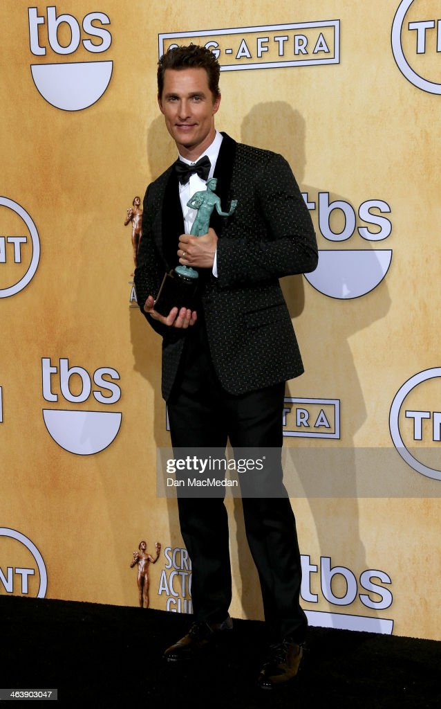 Actor Matthew McConaughey poses in the press room with the award for Outstanding Performance by a Male Actor in a Leading Role for 'Dallas Buyers Club' at the 20th Annual Screen Actors Guild Awards at the Shrine Auditorium on January 18, 2014 in Los Angeles, California.