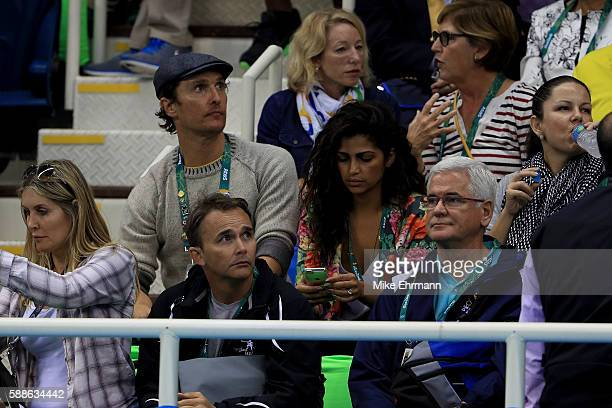Actor Matthew McConaughey talks with his wife Camila Alves during the evening swim session on Day 6 of the Rio 2016 Olympic Games at the Olympic...