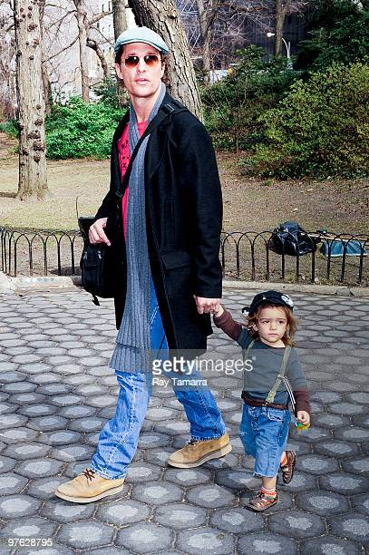 Actor Matthew McConaughey walks his son Levi McConaughey to the Central Park Zoo on March 10, 2010 in New York City.
