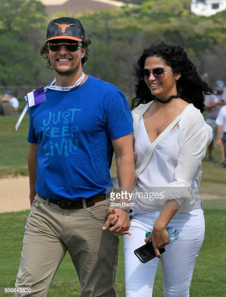 Actor Matthew McConaughey walks with his wife Camila Alves along the 15th hole during round two of the World Golf ChampionshipsDell Technologies...