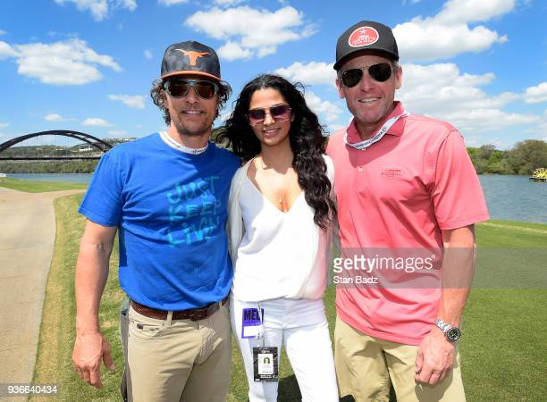 Actor Matthew McConaughey wife Camila Alves and Lance Armstrong former professional road racing cyclist pose for a photo during round two of the...