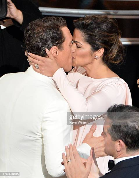 Actor Matthew McConaughey winner of the Best Performance by an Actor in a Leading Role award for 'Dallas Buyers Club' with model Camila Alves onstage...
