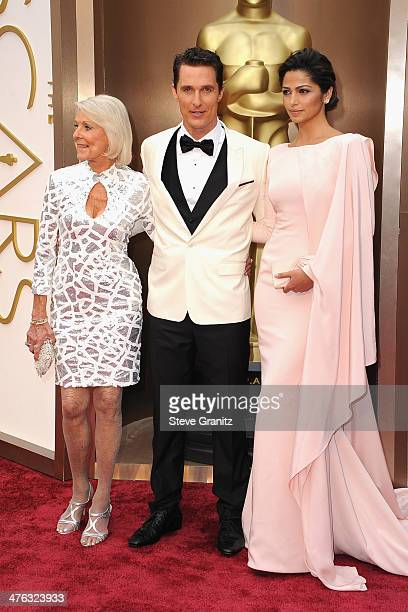 Actor Matthew McConaughey with mother Mary Kathlene and model Camila Alves attends the Oscars held at Hollywood Highland Center on March 2 2014 in...