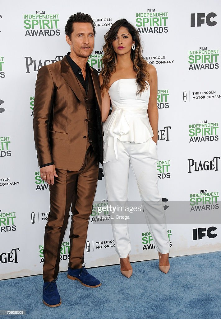 Actor Matthew McConnaughey and model/wife Camilla Alves arrive for the 2014 Film Independent Spirit Awards held at the beach on March 1, 2014 in Santa Monica, California.