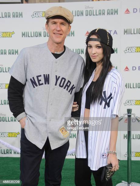 Actor Matthew Modine and daughter Ruby Wylder Rivera Modine arrive at the Los Angeles premiere of Million Dollar Arm at the El Capitan Theatre on May...