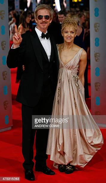 US actor Matthew Modine and his wife Caridad Rivera arrive on the red carpet for the BAFTA British Academy Film Awards at the Royal Opera House in...