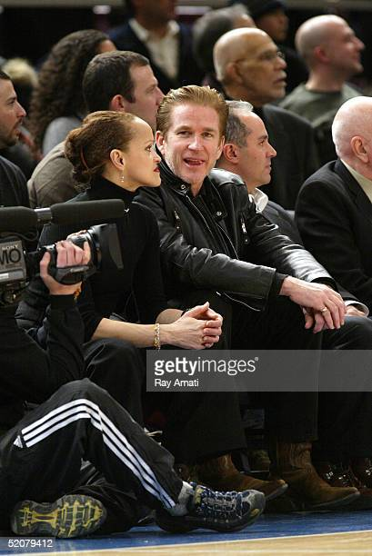 Actor Matthew Modine and his wife Caridad Rivera sit courtside during the Cleveland Caveliers v New York Knicks NBA game at Madison Square Garden on...