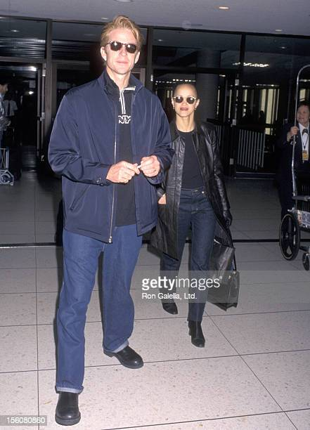 Actor Matthew Modine and wife Caridad Rivera on January 19 1998 departing from the Los Angeles International Airport in Los Angeles California