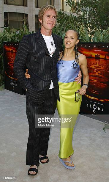 Actor Matthew Modine arrives with his wife Caridad Rivera at the world premiere of Signs on July 29 2002 at the Allice Tully Hall in New York City