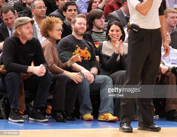Actor Matthew Modine wife Caridad Rivera guest and Olivia Munn attend the Atlanta Hawks vs New York Knicks game at Madison Square Garden on February...
