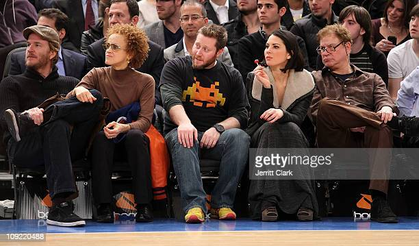 Actor Matthew Modine wife Caridad Rivera guest Olivia Munn and Robert Wuhl attend the Atlanta Hawks vs New York Knicks game at Madison Square Garden...