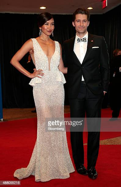 Actor Matthew Morrison right and guest arrive for the White House Correspondents' Association dinner in Washington DC US on Saturday May 3 2014 The...