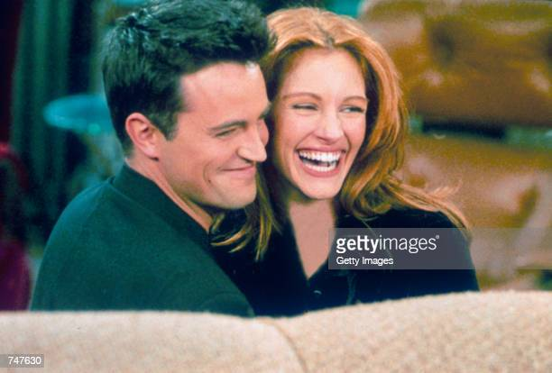 "Actor Matthew Perry and actress Julia Roberts hug each other on the set of ""Friends."""