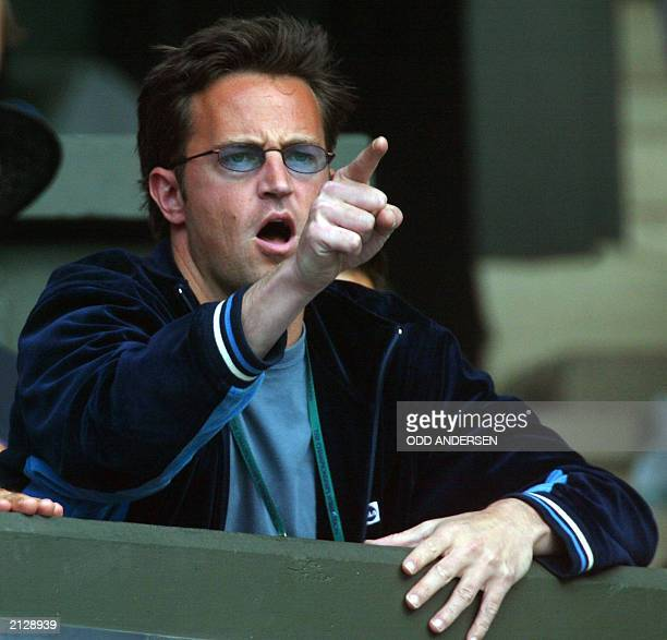 Actor Matthew Perry reacts after a point made my his girl friend Jennifer Capriati of the US during her quarter final round match against Serena...