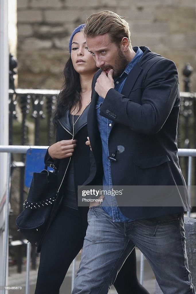 Actor Matthias Schoenaerts and his girflriend pictured attending the funeral service for former Prime Minister Wilfried Martens on October 20, 2013 in Gent, Belgium.