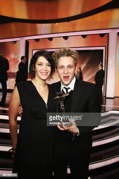 Actor Matthias Schweighoefer poses with his award 'Best Actor National' with partner Anni Schramm during the Goldene Kamera 2010 Award at the Axel...