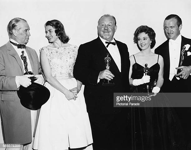 Actor Maurice Chevalier with the Best Picture Oscar for 'Gigi' with winners David Niven Susan Hayward and Burl Ives and presenter Ingrid Bergman at...