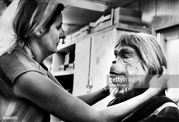 Actor Maurice Evans being made up for his role as the simian heavy in the motion picture Planet of the Apes