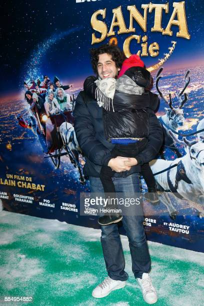 Actor Max Boublil and his daughter attend 'Santa Cie' Paris Premiere at Cinema Pathe Beaugrenelle on December 3 2017 in Paris France