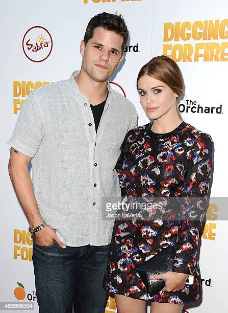 Actor Max Carver and actress Holland Roden attend the premiere of 'Digging For Fire' at ArcLight Cinemas on August 13 2015 in Hollywood California