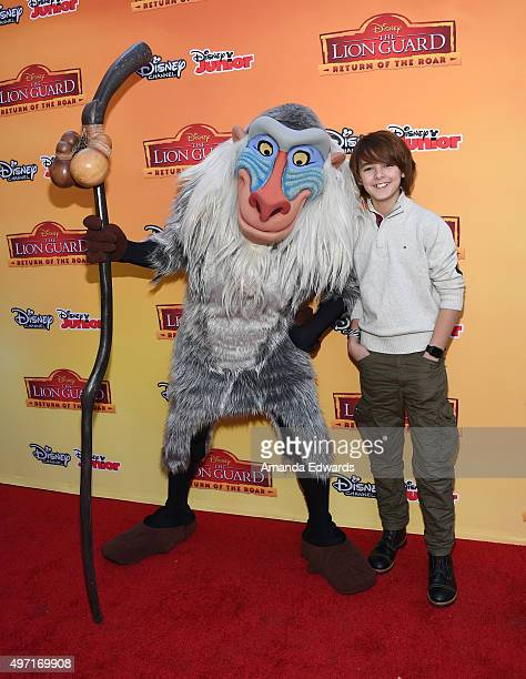 """Actor Max Charles and Rafiki arrive at the premiere of Disney Channel's """"The Lion Guard: Return Of The Roar"""" at Walt Disney Studios on November 14,..."""