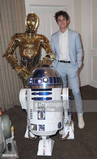 Actor Max Charles poses with C3PO and R2D2 at the After Party at the Academy Of Science Fiction, Fantasy & Horror Films' 44th Annual Saturn Awards...